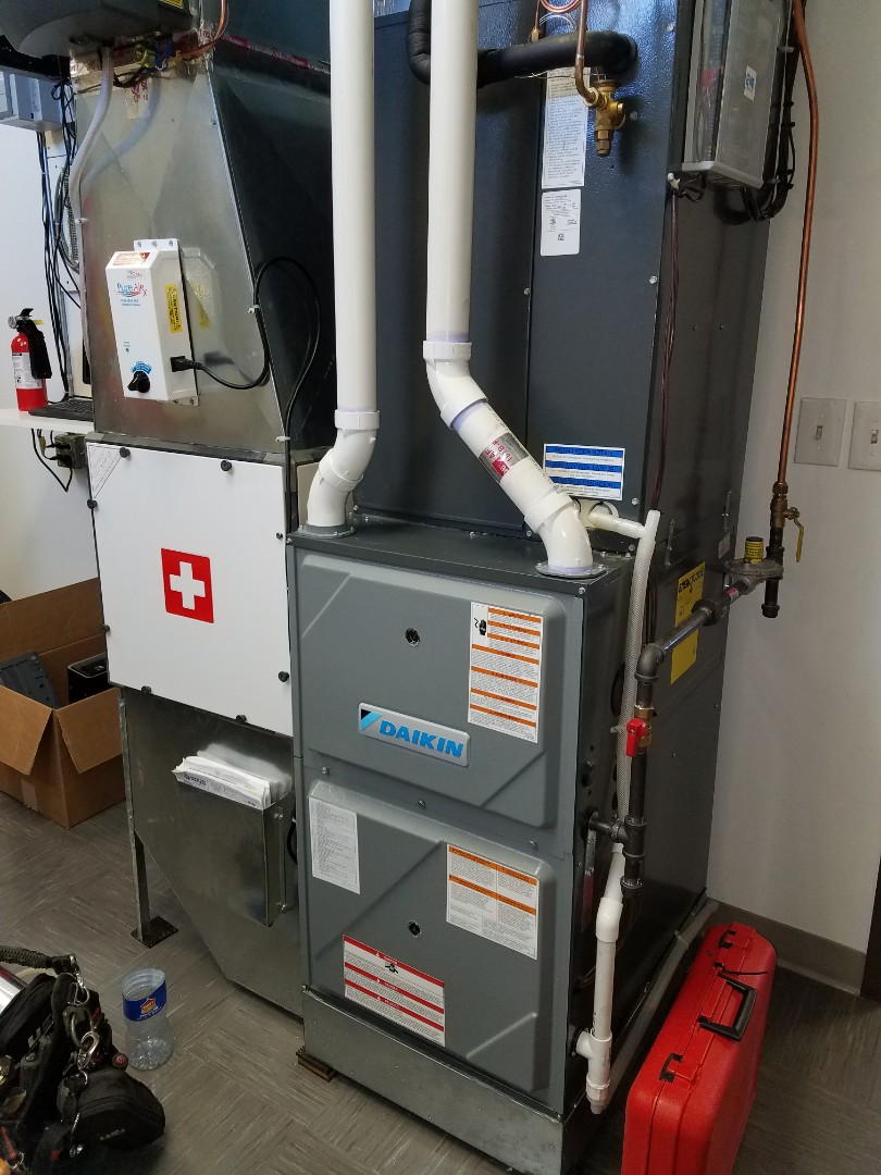 Osseo, MN - Daikin furnace tune up and clean.  Renewaire ERV tune up and clean.  Comfort Matters humidifer tune up and clean