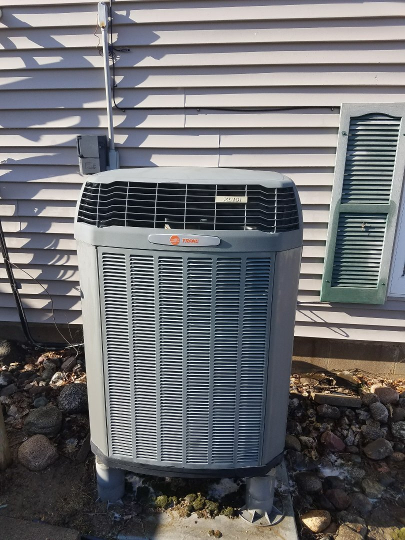 Minneapolis, MN - Heat pump service. Performed a cleaning and tune up on Trane air source heat pump and installed a motor booster.