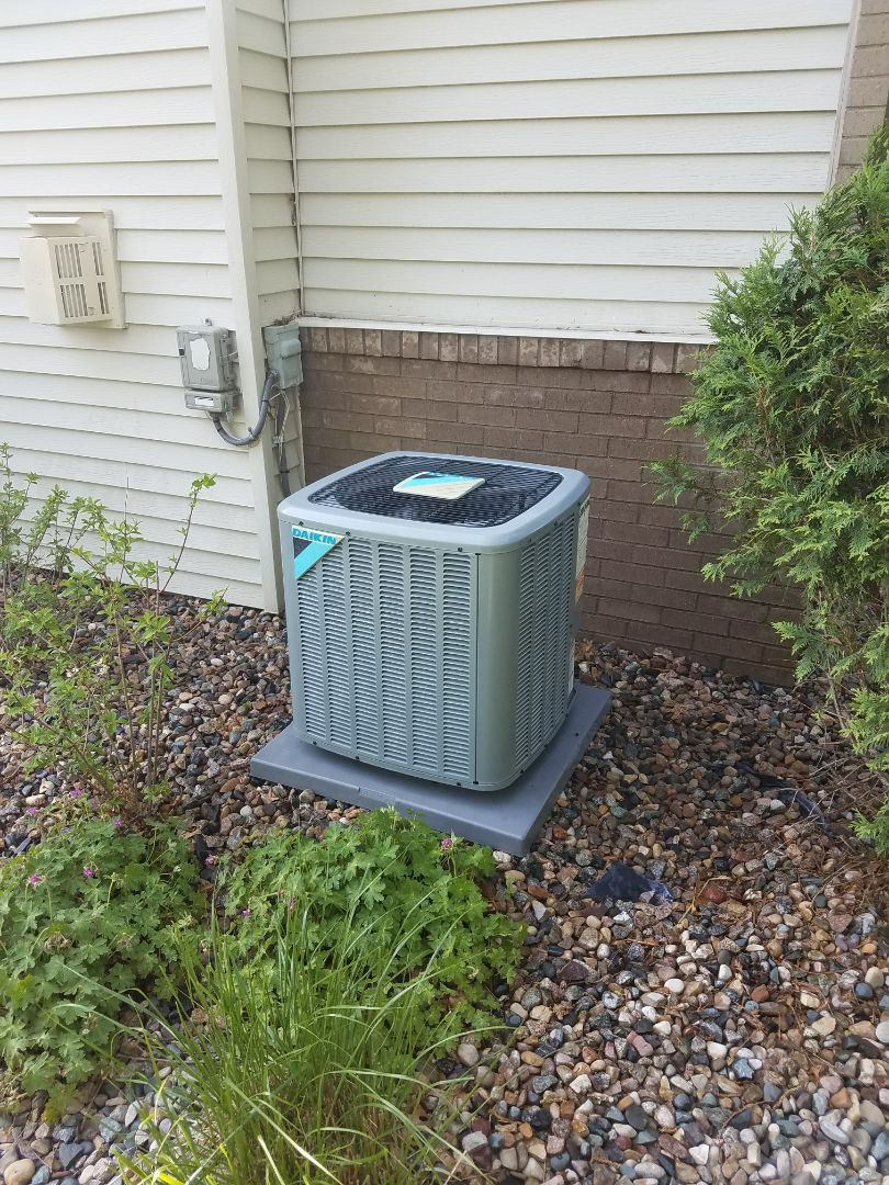 Minnetonka, MN - Air conditioner maintenance. Performed a cleaning and tune up on a Daikin AC. Also installed a drain pan treatment.
