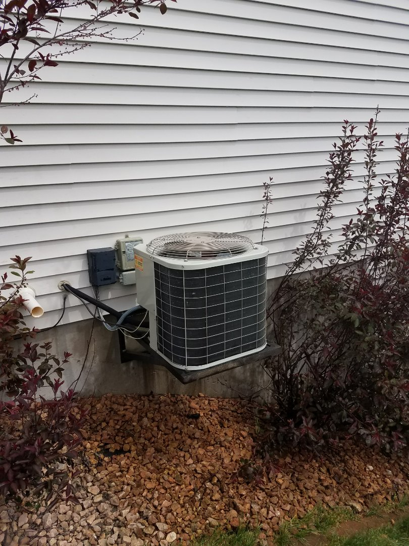 Golden Valley, MN - AC service. Installed a motor booster and performed a cleaning and tune up on a Bryant air conditioner.