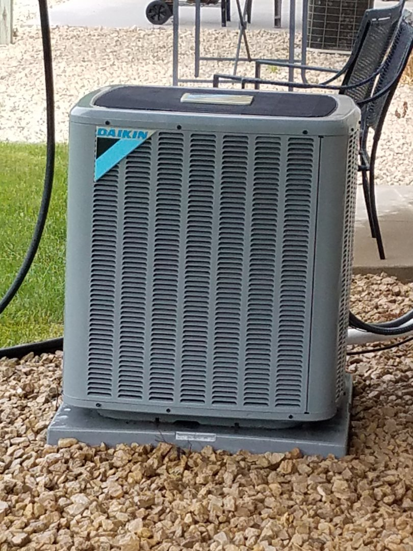 Rockford, MN - Air conditioning maintenance. Performed a cleaning and tune up on a Daikin AC. Also installed a drain pan treatment.