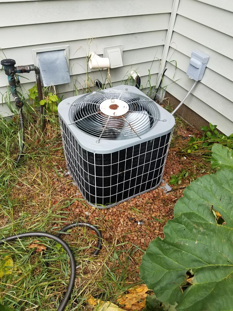 Rogers, MN - AC service. Performed a cleaning and tune up on a Carrier air conditioner and installed a capacitor. Also performed a cleaning on a Venamr HRV air exchanger.