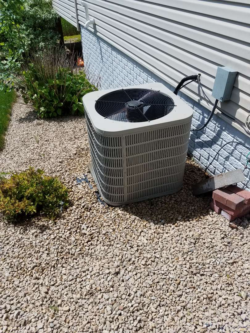 Rogers, MN - A/C tune up and clean on Goodman unit in Roger's. Also replaced 35/5 capacitor