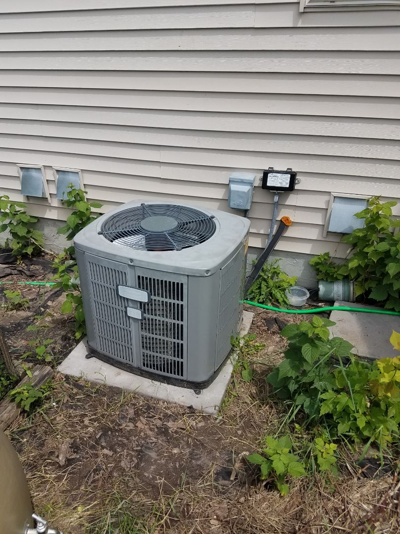Plymouth, MN - Air conditioner service. Installed a capacitor and performed a cleaning and tune up on an American Standard AC.