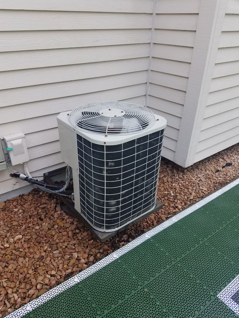 Maple Grove, MN - AC service. Installed a motor booster and performed a cleaning and tune up on a Bryant air conditioner.