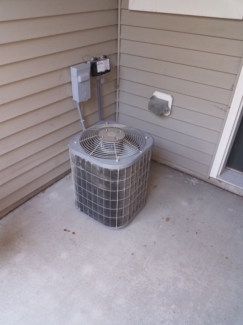 Plymouth, MN - AC service. Installed a capacitor on a Carrier air conditioner.