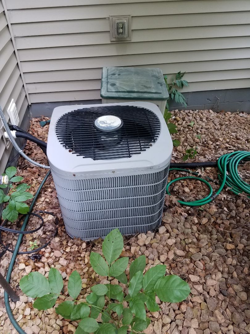 Hanover, MN - A/C tune up and clean in carrier unit in Hanover. Installed new capacitor and added leak sealant into the system.