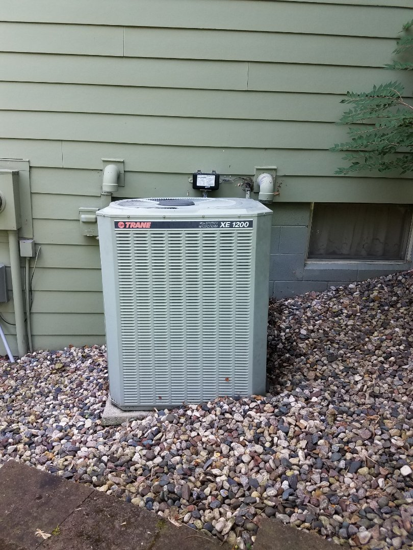 Minneapolis, MN - Air conditioner service. Installed a motor booster and performed a cleaning and tune up on a Payne AC.