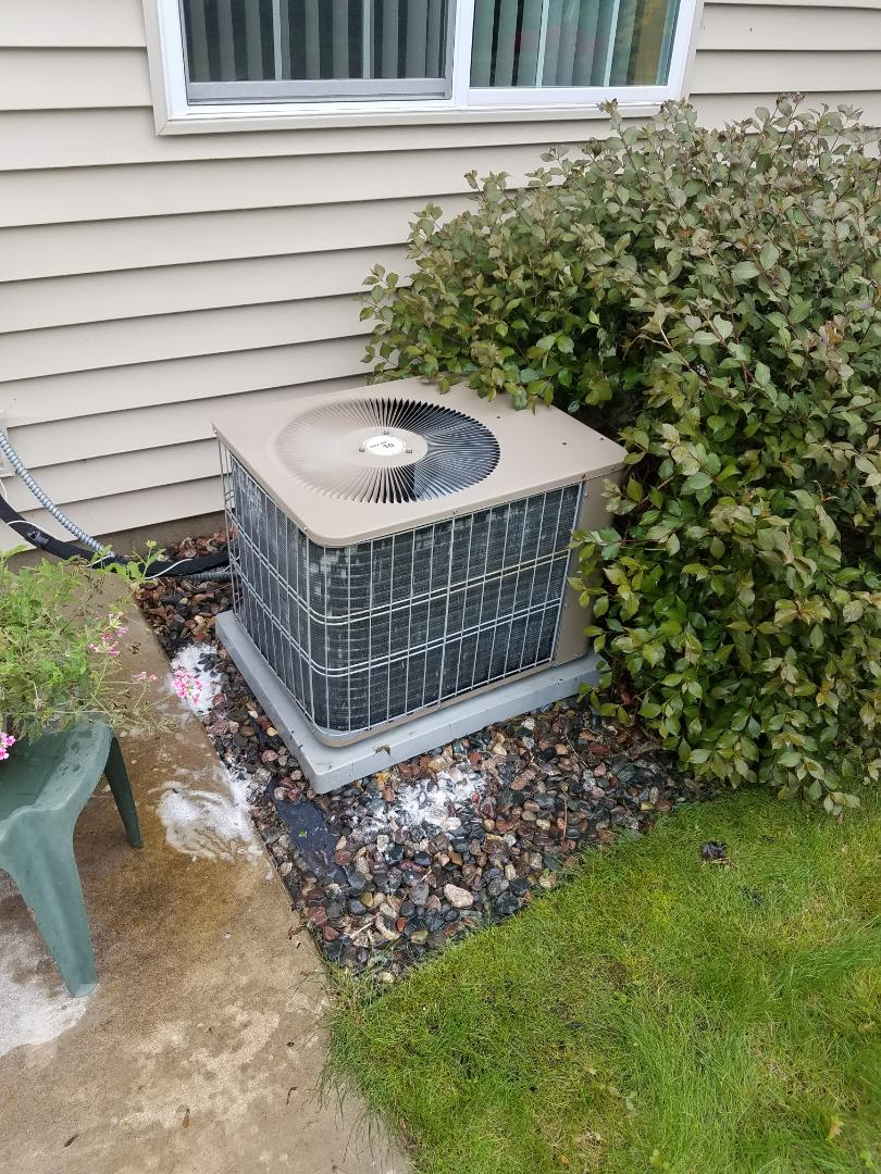 Big Lake, MN - Air conditioning service. Installed a capacitor on a Luxaire air conditioner.