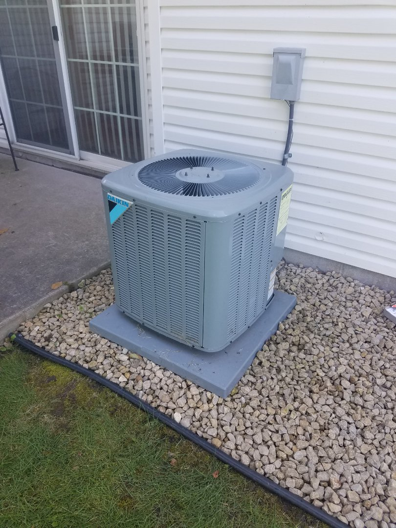 Saint Michael, MN - AC service. Repaired a leaking copper line and charged with R410A refrigerant on a Daikin air conditioner.