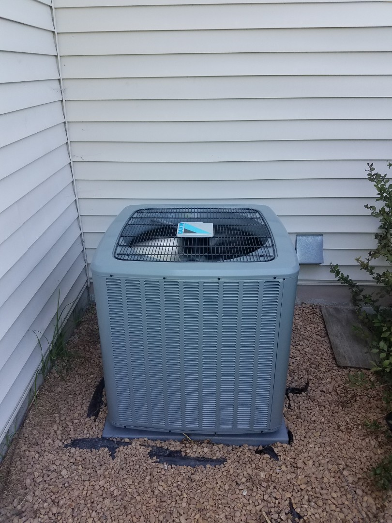 Osseo, MN - Air conditioning service. Removed refrigerant on a Daikin air conditioner.