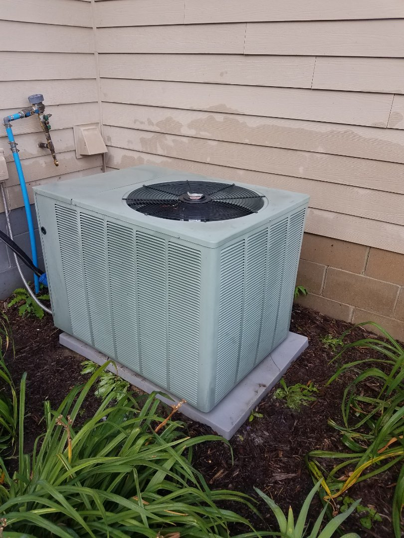 Rockford, MN - Air conditioner service. Performed a cleaning and tune up on a Ruud AC.
