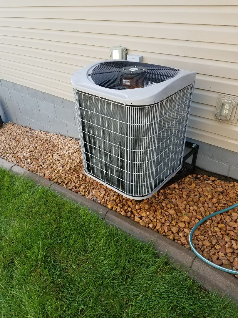 Otsego, MN - A/C tune up and clean on carrier condensing unit in Otsego