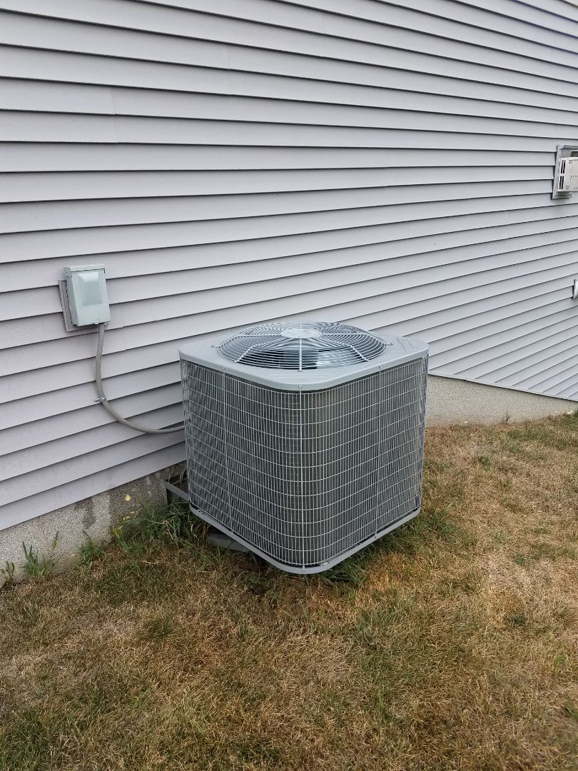 Rogers, MN - Air conditioning service. Installed a motor booster on a Carrier air conditioner.