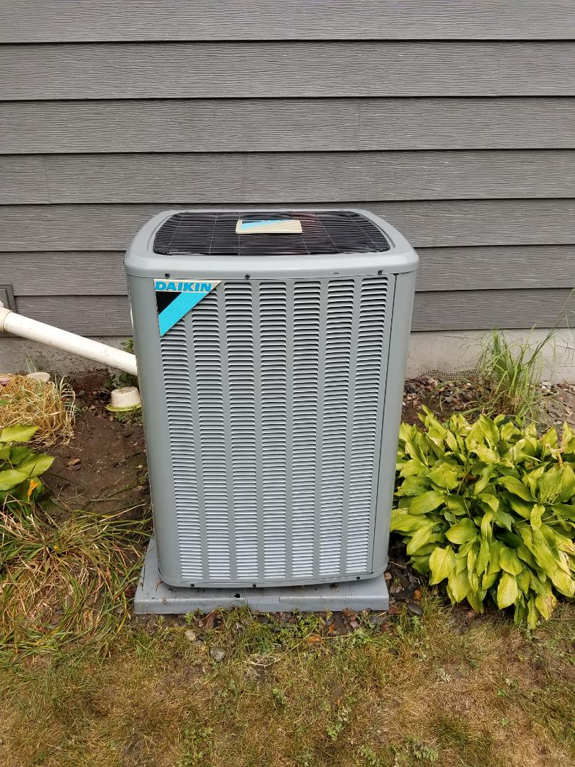Albertville, MN - A/C tune up and clean on daikin condenser unit in Albertville