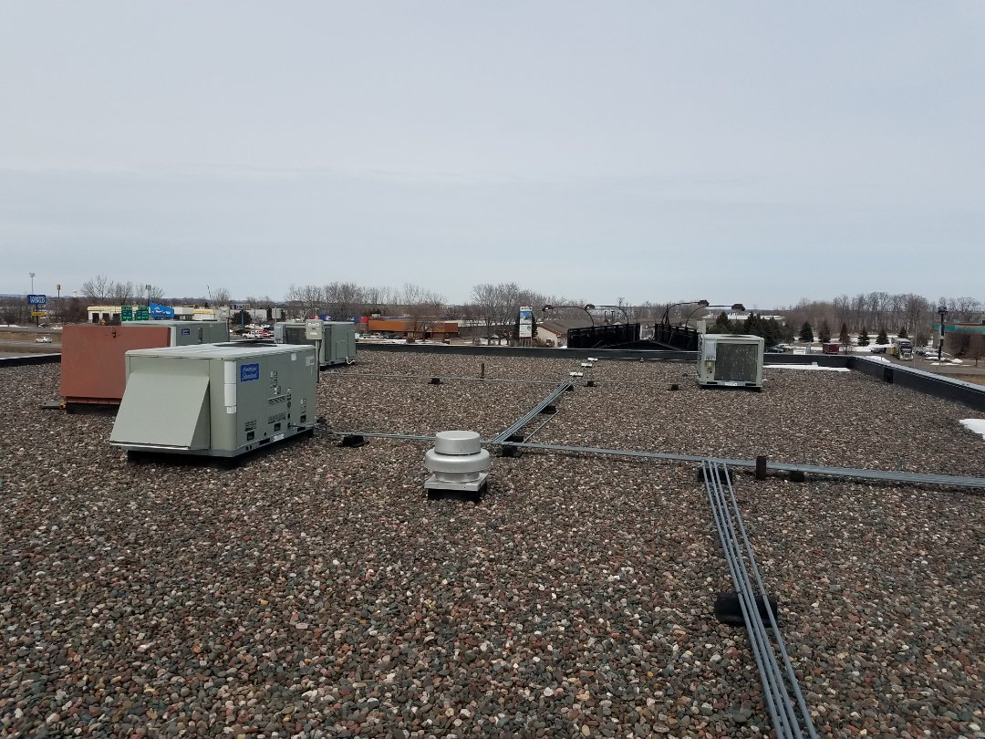 Rogers, MN - Commercial maintenance on 8 American standard rooftop units in Rogers