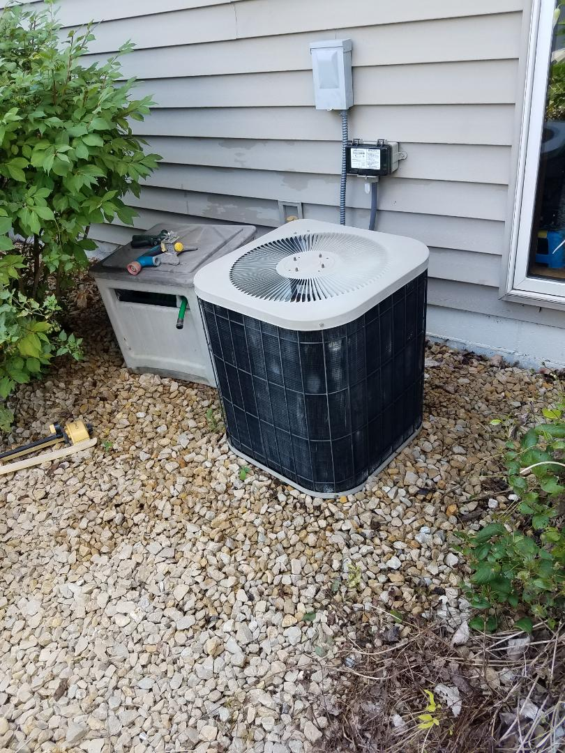 Osseo, MN - AC tune up and clean on carrier unit in Maple Grove