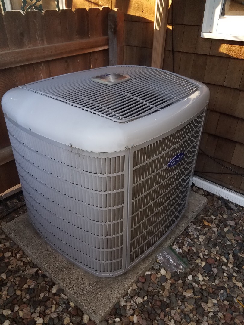 Osseo, MN - Air conditioner service. Installed a new motor booster on a Carrier AC.