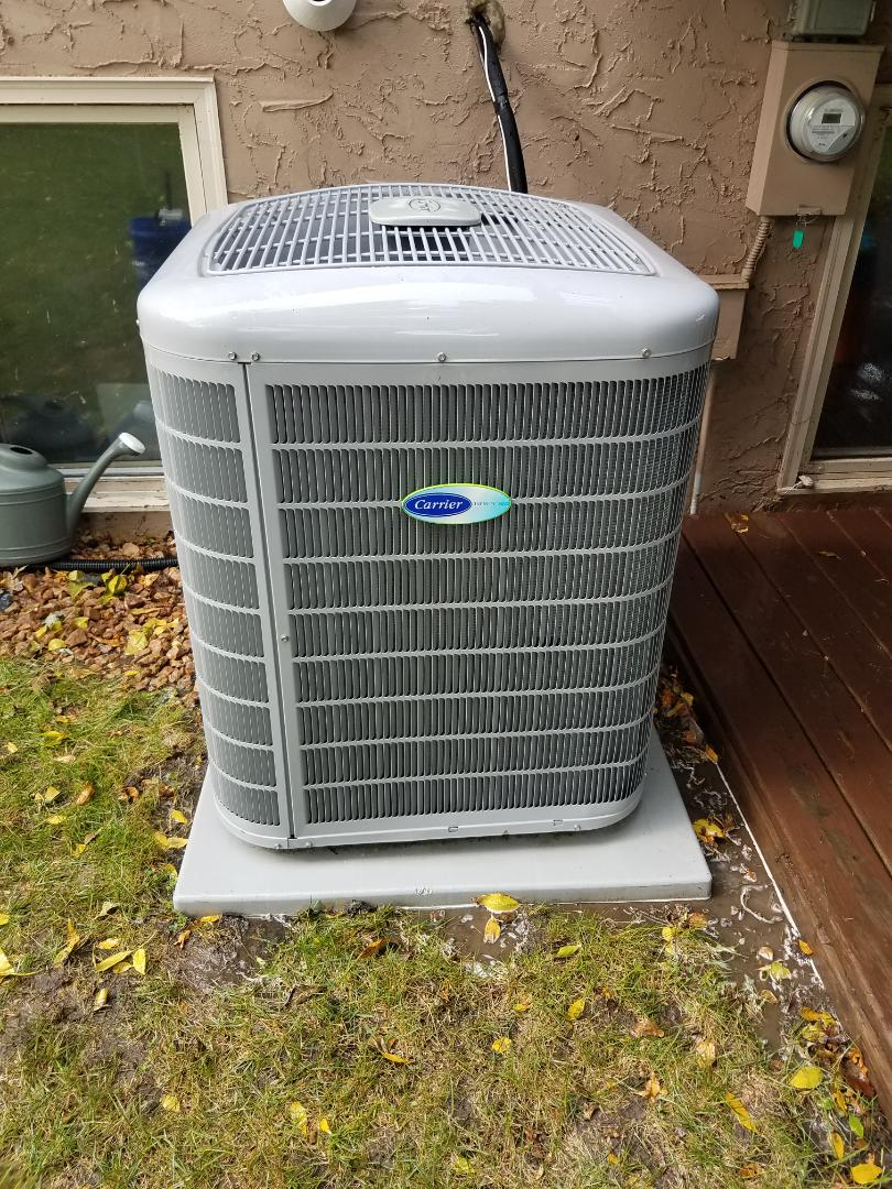 Osseo, MN - Air conditioning tune up and cleaning on carrier air conditioner