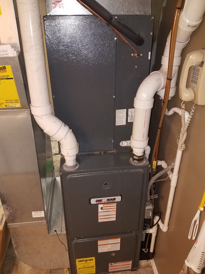 Corcoran, MN - Air conditioner service. Performed a drain line cleaning on a Goodman air conditioner.