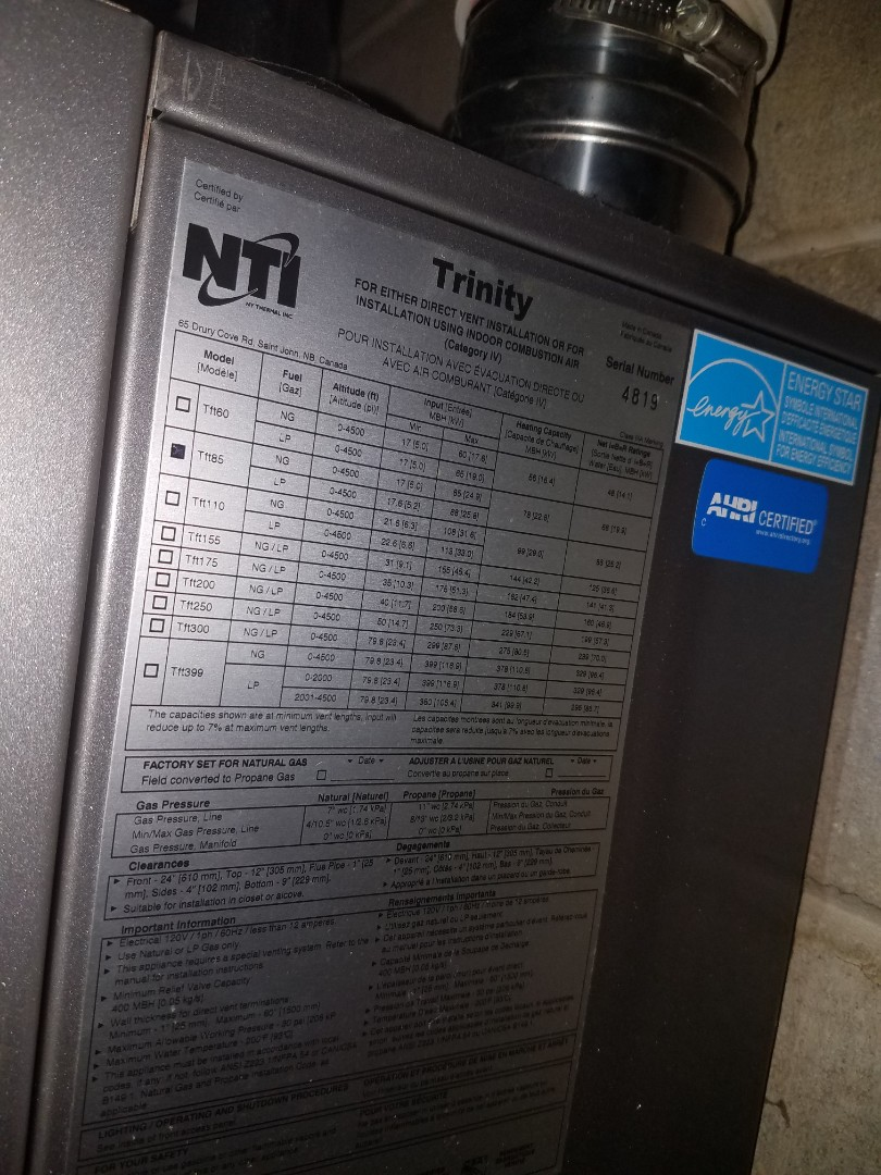 Minneapolis, MN - Boiler service. Filled boiler with water to proper level and test operation of NTI Trinity boiler.