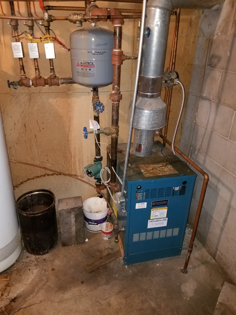 Buffalo, MN - Boiler repair. Install a pressure and temperature gauge, Honeywell zone valve and performed a cleaning and tune up on a Burnham boiler.