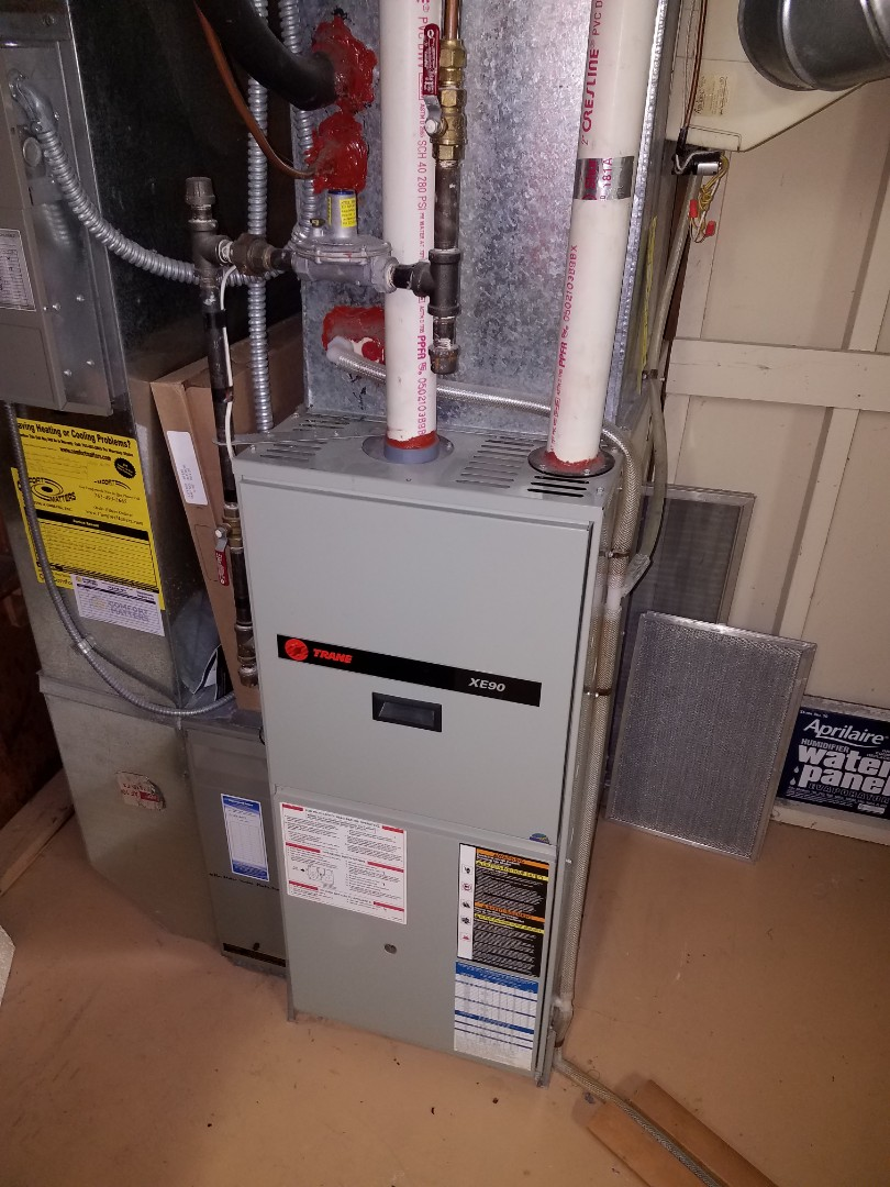 Minnetonka, MN - Furnace service. Installed a blower motor and capacitor on a Trane furnace.