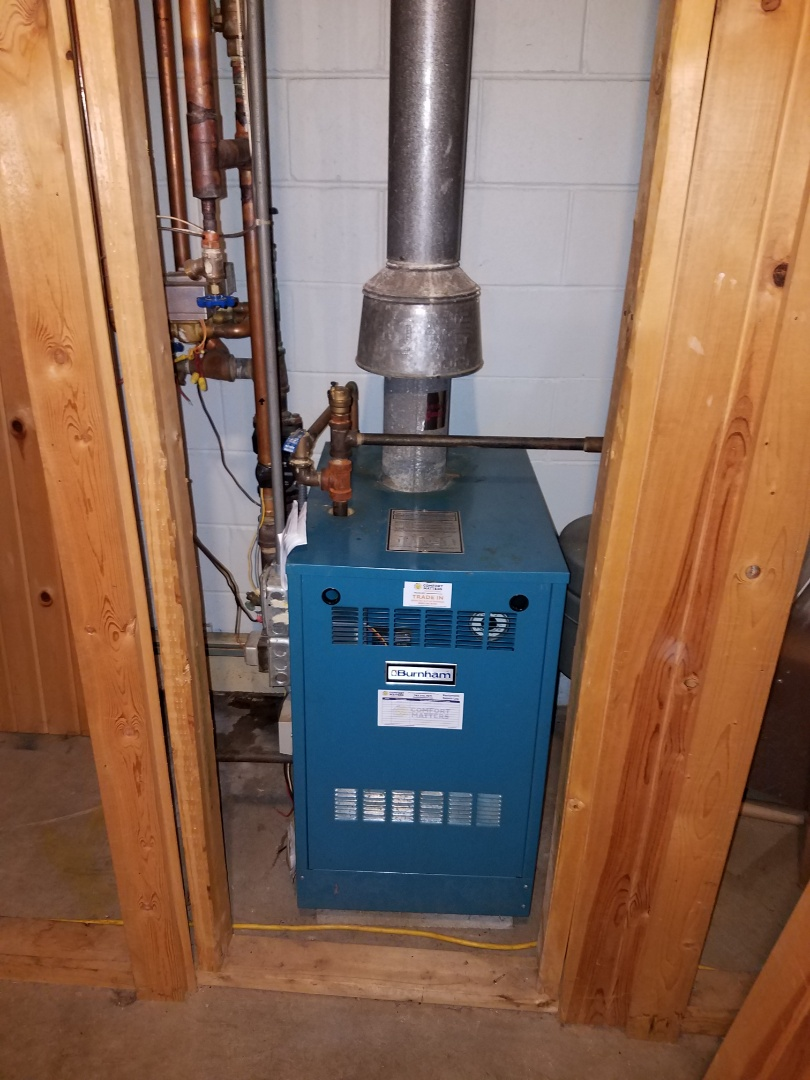 Buffalo, MN - Heating service. Installed a Honeywell spark ignition board on a Burnham boiler. Also performed a cleaning and tune up.