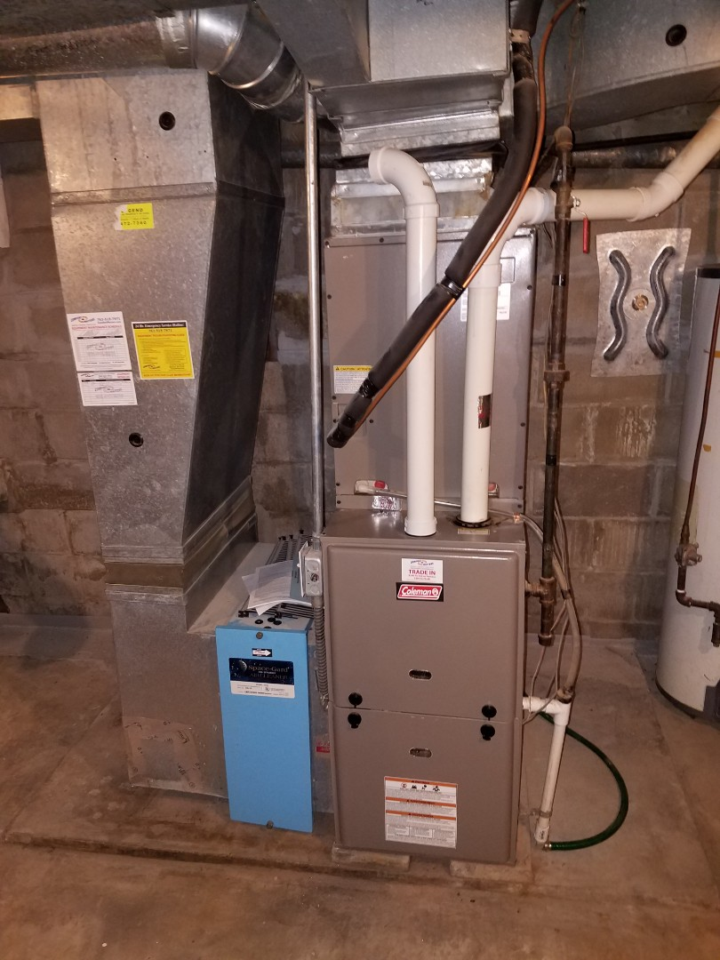 Buffalo, MN - Furnace service. Installed an inducer motor, flame sensor, and hot surface igniter on a Coleman furnace.
