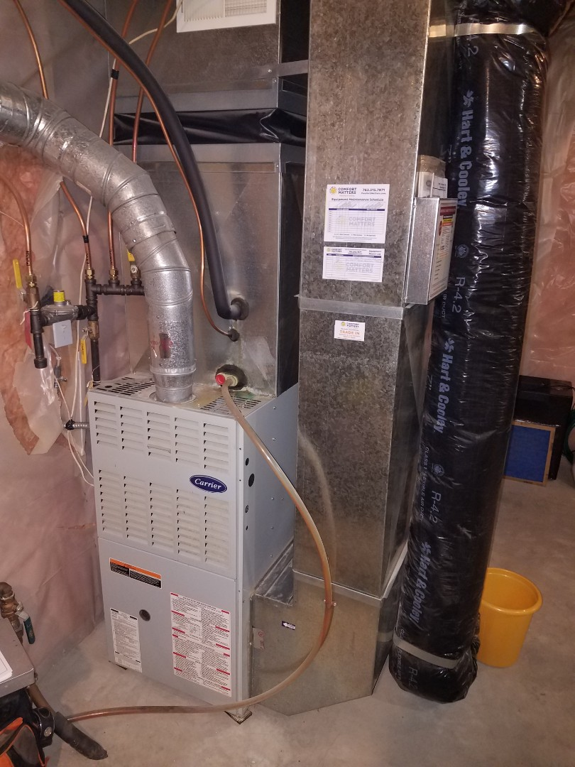 Osseo, MN - Furnace service. Installed a heat exchanger,  flame sensor and performed a blower wheel cleaning on a Carrier furnace.