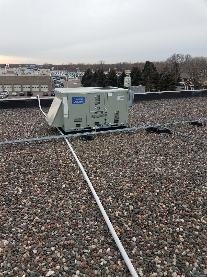 Rogers, MN - Commercial service. Installed a temperature safety sensor and performed a wiring repair on an American Standard heating unit.
