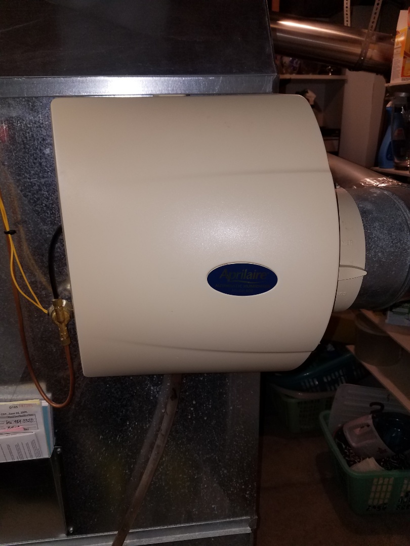 Blaine, MN - Humidifier service. Installed a drain fitting on an Aprilaire humidifier.