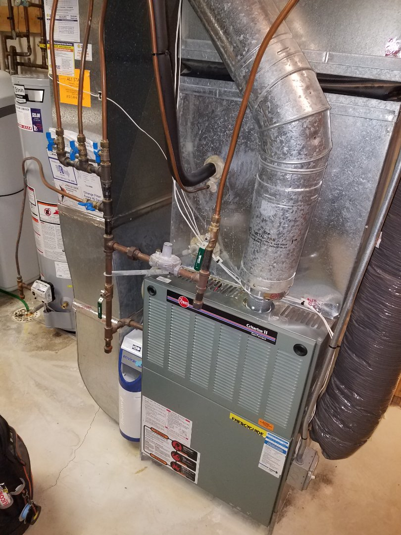 Osseo, MN - Furnace service. Installed an igniter, flame sensor, and Honeywell filter on a Rheem furnace. Also performed a cleaning and tune up on the furnace and blower wheel.