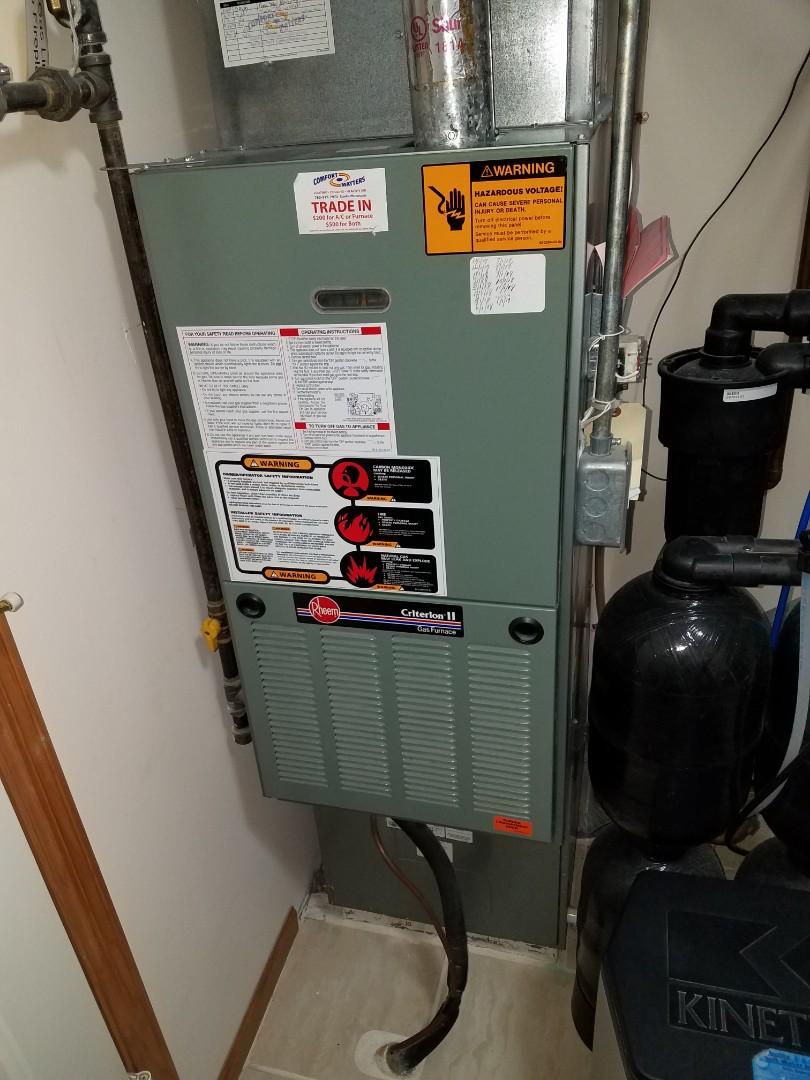 Saint Michael, MN - Furnace service. Installed an exhaust motor on a Rheem furnace.