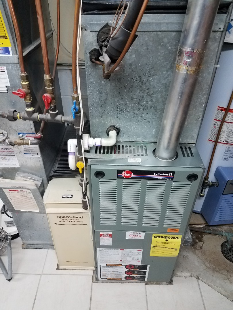 Monticello, MN - Heating maintenance. Performed cleaning and tune up on a Rheem furnace.