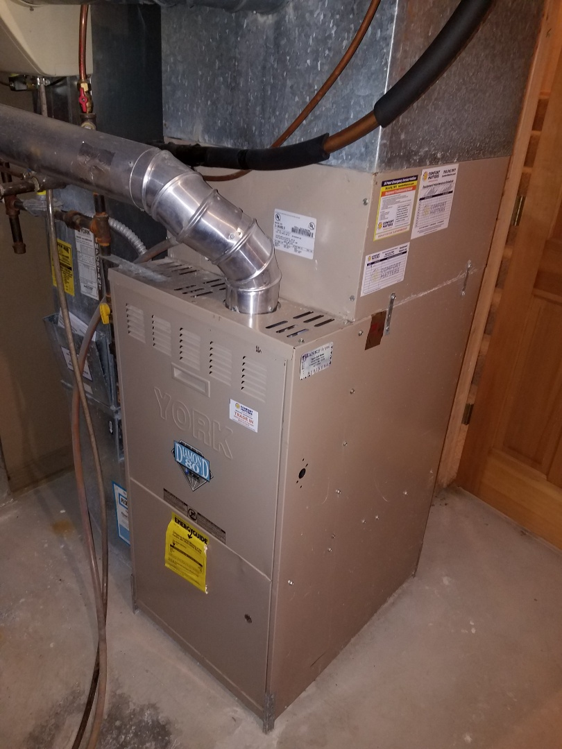 Champlin, MN - Furnace service. Performed a cleaning on the pressure switch assembly on a York furnace.