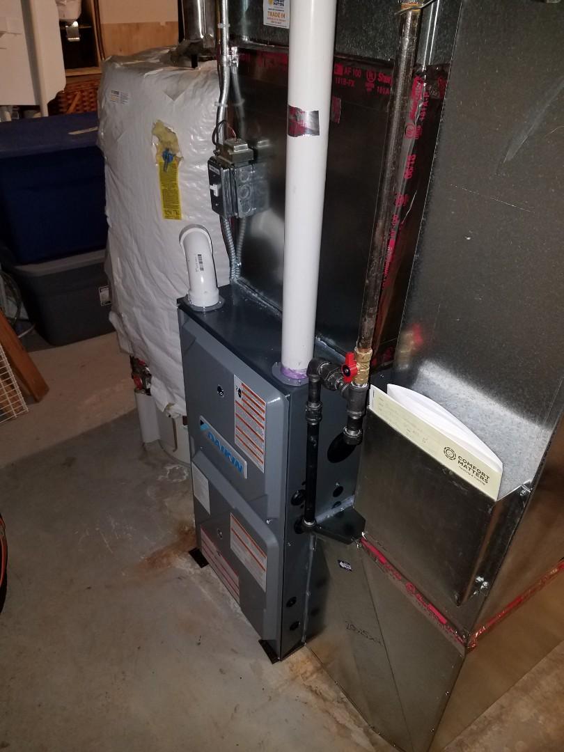 Osseo, MN - Furnace service. Installed a warranty pressure switch assembly on a Daikin furnace.