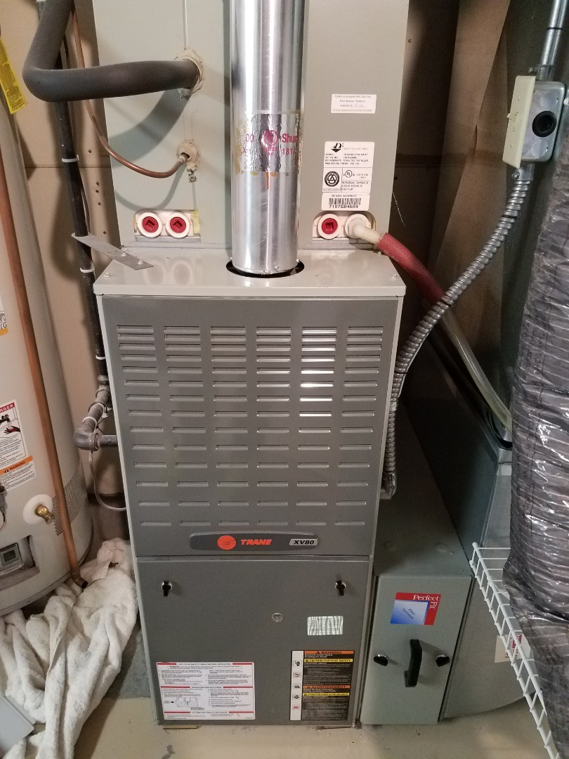 Saint Michael, MN - Furnace maintenance. Performed tune up and cleaning on a Trane furnace.