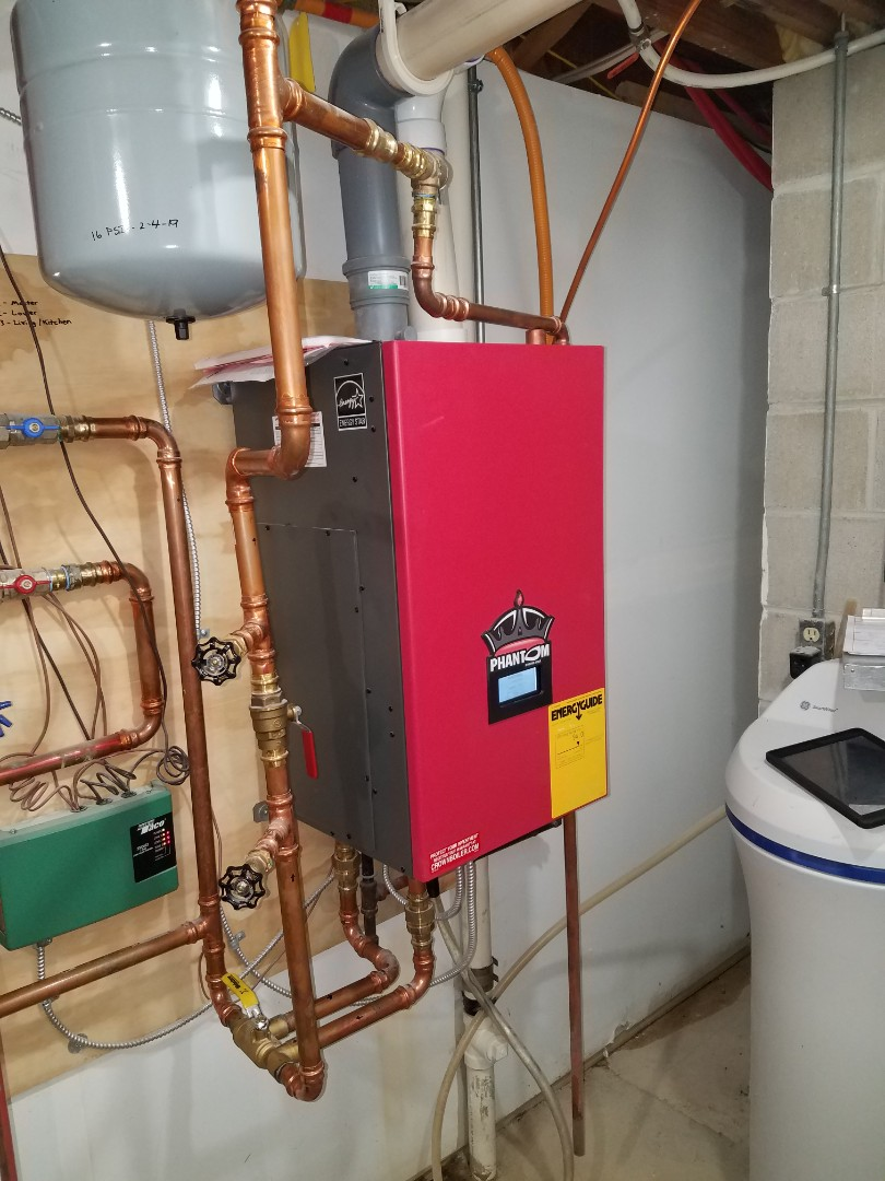 Plymouth, MN - Boiler service. Repaired a leak in the aluminum fin tube radiator on a Phantom Crown boiler
