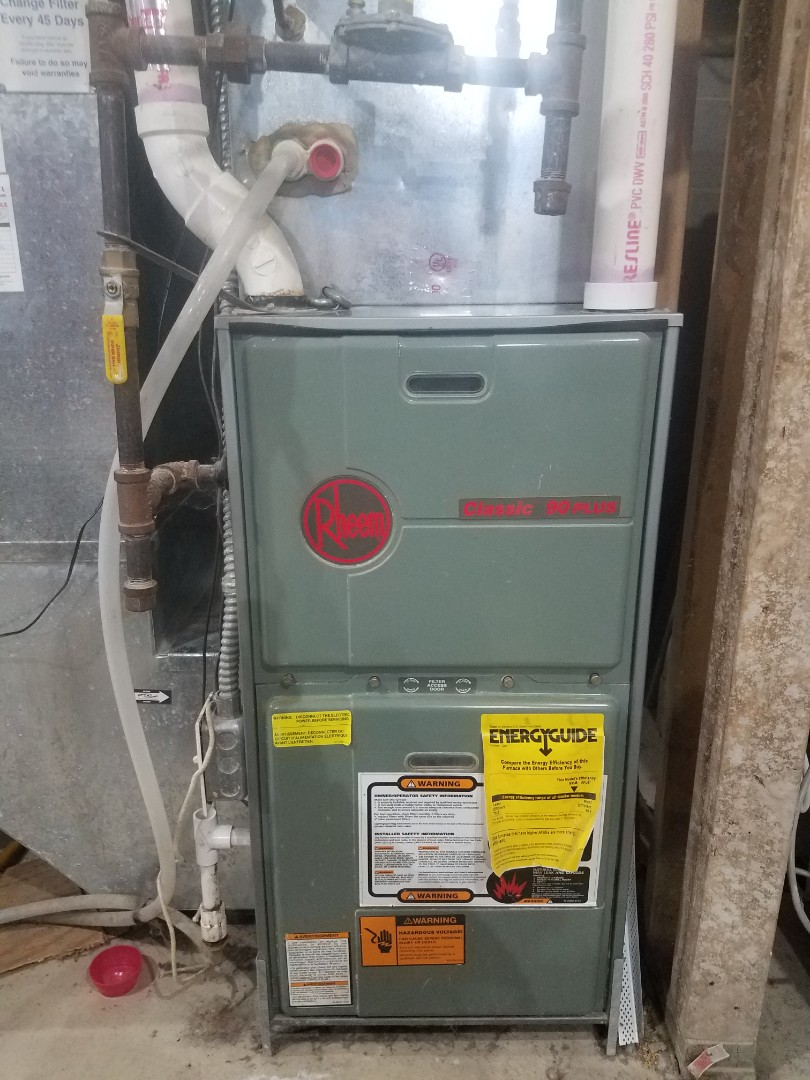 Saint Michael, MN - Furnace maintenance. Performed tune up and cleaning on a Rheem furnace.