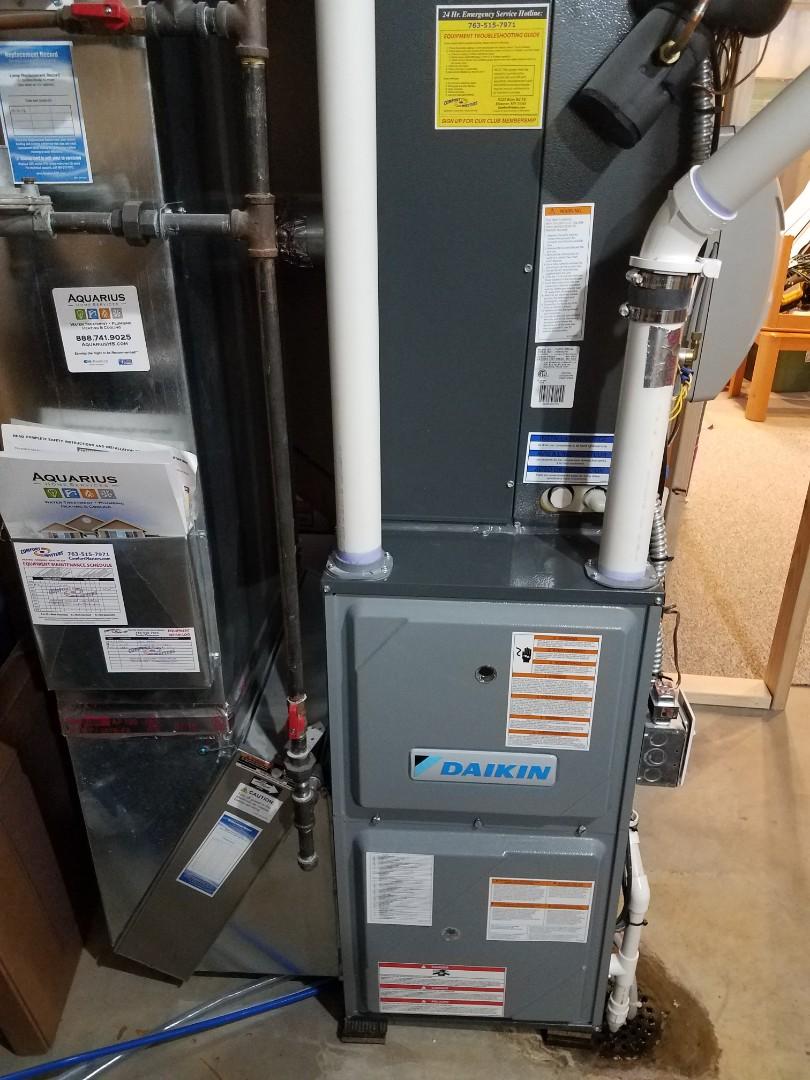 Maple Plain, MN - Furnace maintenance. Replaced main flame safety sensor on a Daikin furnace.