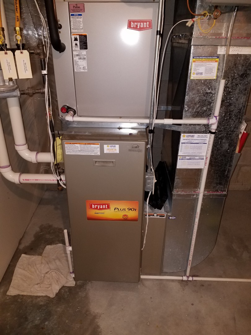 Maple Grove, MN - Heating service. Unplugged a clogged drain line and flushed it out on a Bryant furnace.