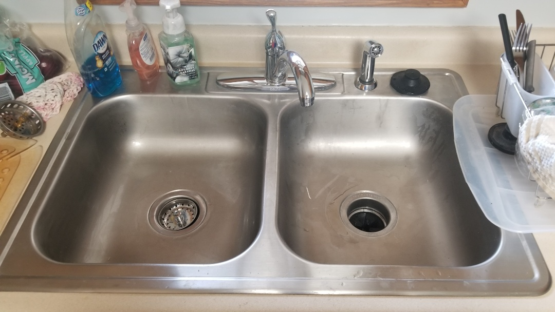New garbage disposal, new kitchen sink faucet,  new shut off valve