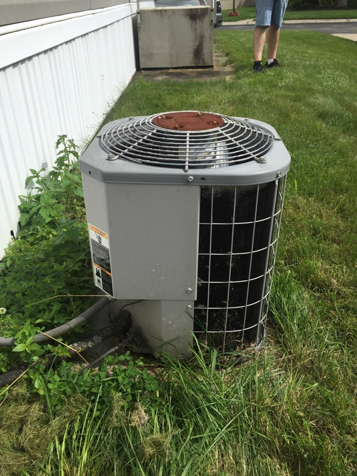 Clinton, MI - Repair service on Carrier Air Conditioner. Tune-up and check refrigerant or Freon levels.
