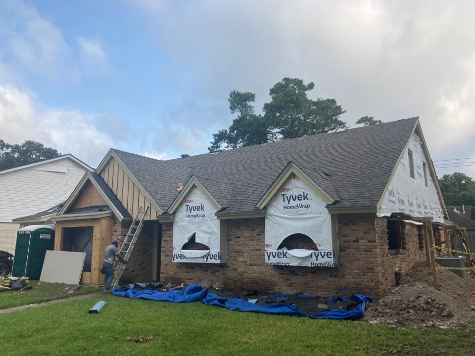 Houston, TX - Day 2 and this roof is really starting to look great! The CertainTeed Weathered Wood shingles really pop, and the Attic Breeze solar fan is about to go in next!