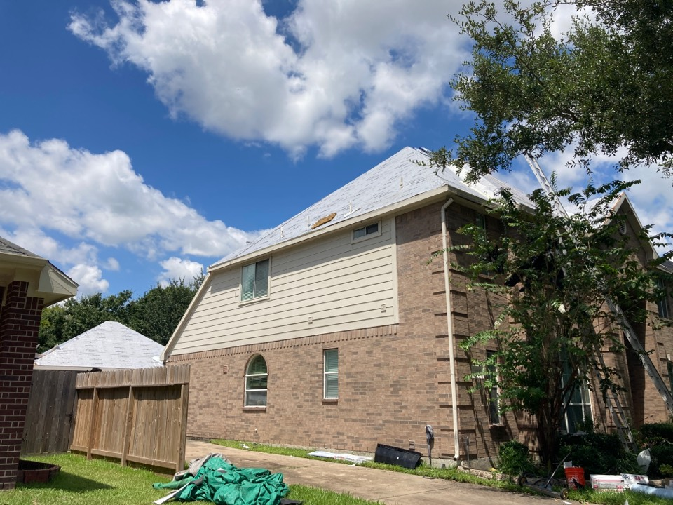 """Pearland, TX - New roof going up today! Roof replacement will be GAF Timberline HDZ shingle Charcoal color. 2"""" Drip edge Almond color. And two Attic Breeze solar fans!"""
