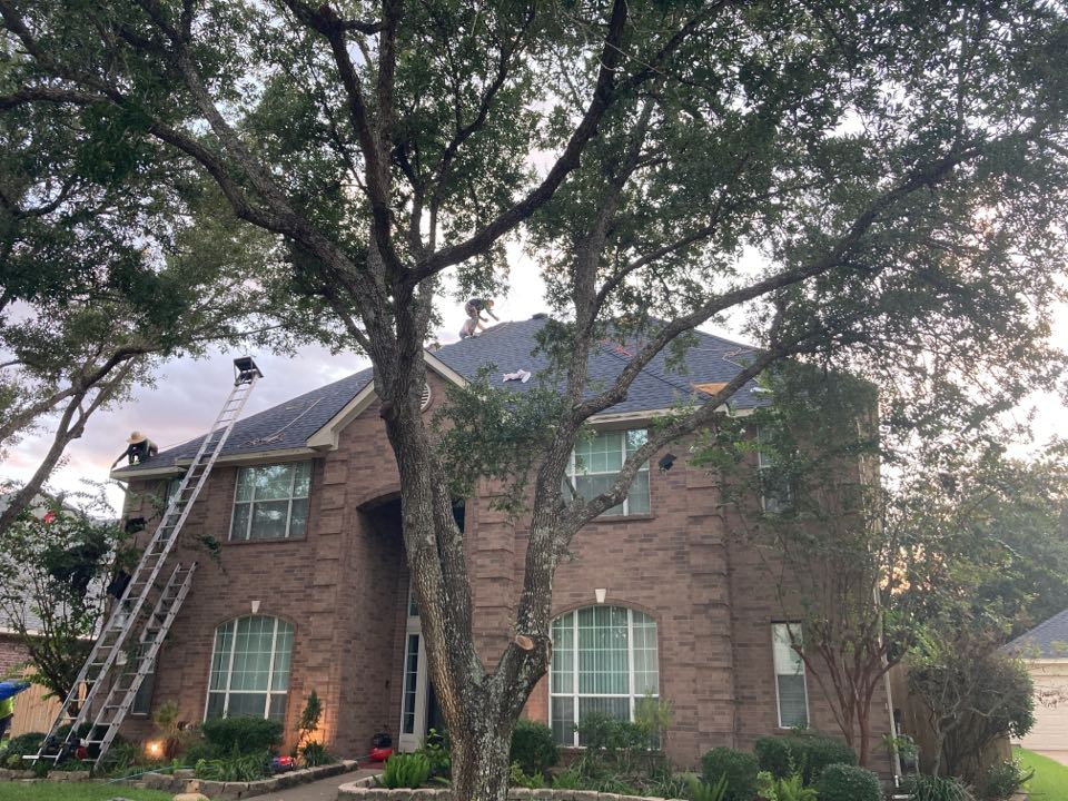 Pearland, TX - Finished with day 1 of the reroof. This roof replacement will be completed in just 2 days! GAF shingles HDZ charcoal and Attic Breeze solar fans.