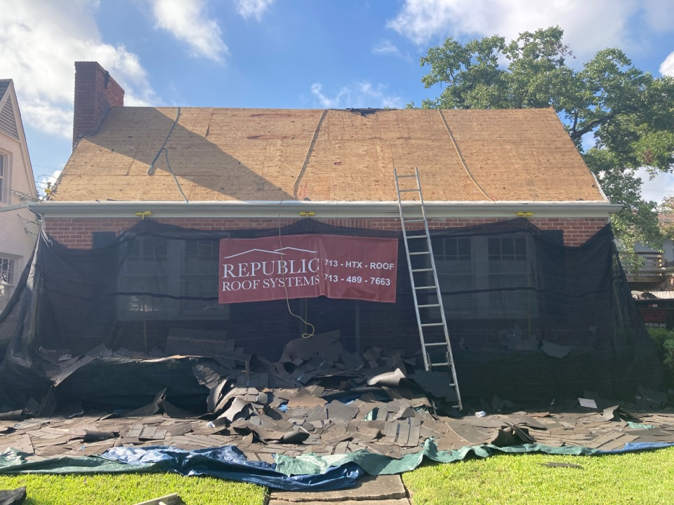 Houston, TX - Reroof in Rice Village / West University Place. Installing a new roof with GAF HDZ shingles and Attic Breeze solar roof fans. Using the Catch-All landscaping protection!