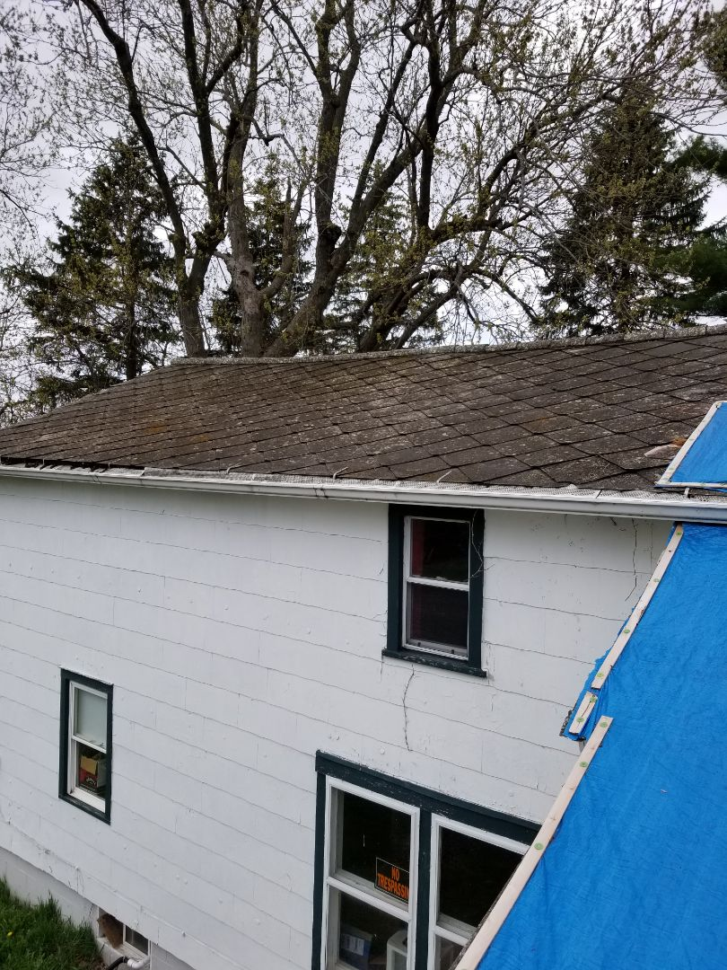Earlville, IL - Tearing off asbestos shingles and install new IKO cambridge architectural shingles