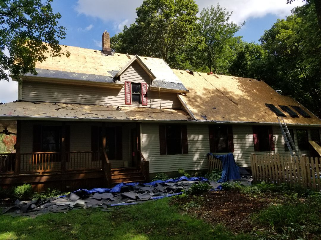 Tear off and replace roofing with IKO Cambridge (Weatherwood) shingles.